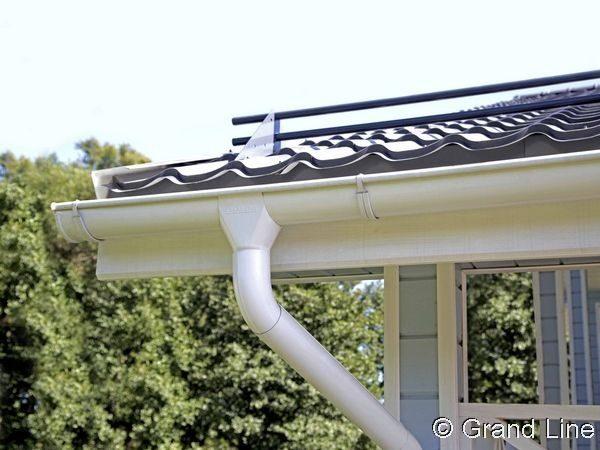 Снегозадержатель Optima на крыше дома